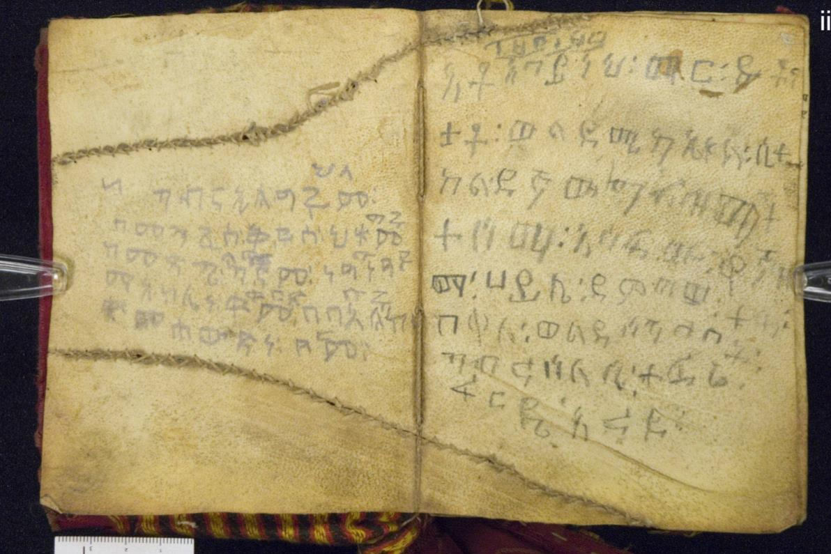 Ethiopic manuscript, two long tears due to skin blemishes, repaired with 'baseball stitches'. The St John's university and the college of St Benedict, USA, Alwan Codex 18.